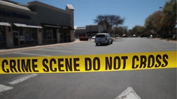 Crime scene tape blocks access to the public as FBI agents collect evidence at a FedEx Office facility following an explosion at a nearby sorting center on March 20, 2018 in Sunset Valley, Texas.