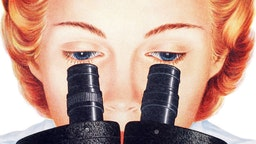 Close-up of a woman scientist looking into the lenses of a microscope, 1954. Screen print.