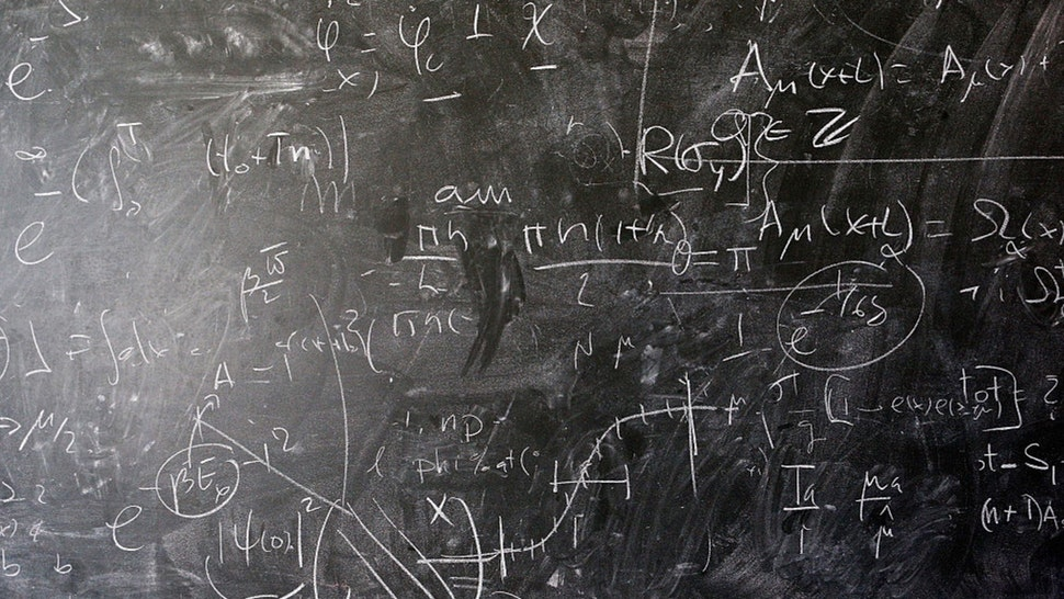 A detailed view of the blackboard with theoretical physics equations in chalk by Alberto Ramos, Theoretical Physics Fellow and visitor, Antonio Gonzalez-Arroyo from the Universidad Autonoma de Madrid.