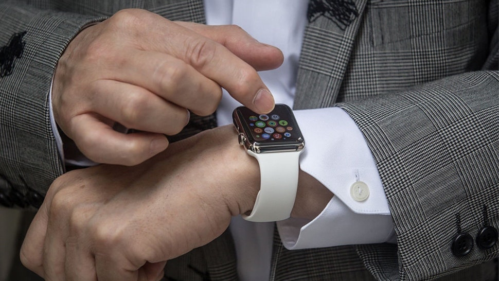 Hajime Shimada shows off his newly purchased Apple Watch outside boutique store, Dover Street Market Ginza on April 24, 2015 in Tokyo, Japan.