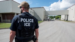 US Immigration and Customs Enforcement's (ICE) special agent preparing to arrest alleged immigration violators at Fresh Mark, Salem, June 19, 2018.