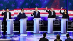 Democratic presidential candidates (L-R) former tech executive Andrew Yang, South Bend, Indiana Mayor Pete Buttigieg, former Vice President Joe Biden, Sen. Bernie Sanders (I-VT) and Sen. Kamala Harris (D-CA)...