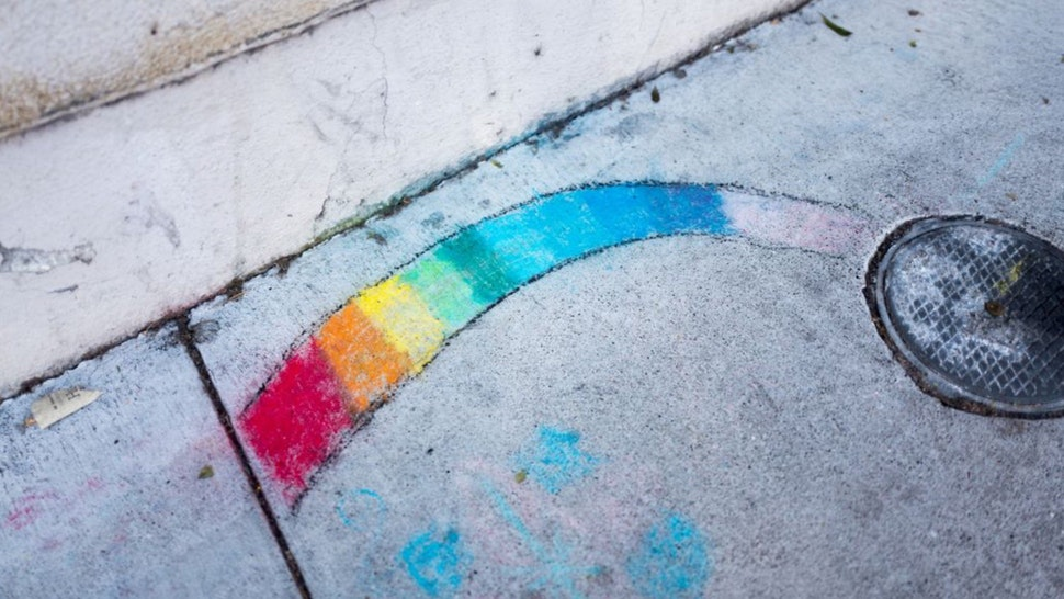 In the Gourmet Ghetto (North Shattuck) neighborhood of Berkeley, California, someone has used sidewalk chalk to draw a rainbow on the sidewalk, a symbol both of the hippie movement and of LGBT rights, October 6, 2017.