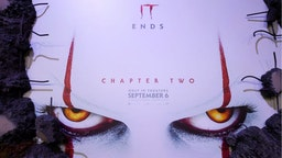 """A poster is seen on the red carpet ahead of the World premiere of """"It Chapter Two"""" at the Regency Village theatre in Westwood, California on August 26, 2019."""