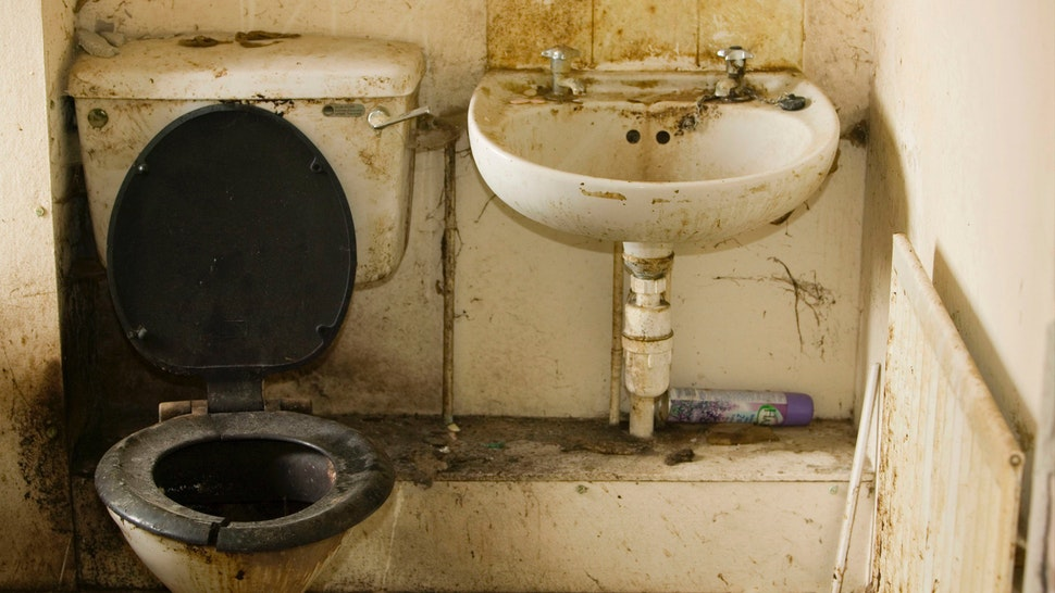 A disgustingly dirty bathroom in an abandoned council house in Carlisle Cumbria UK.