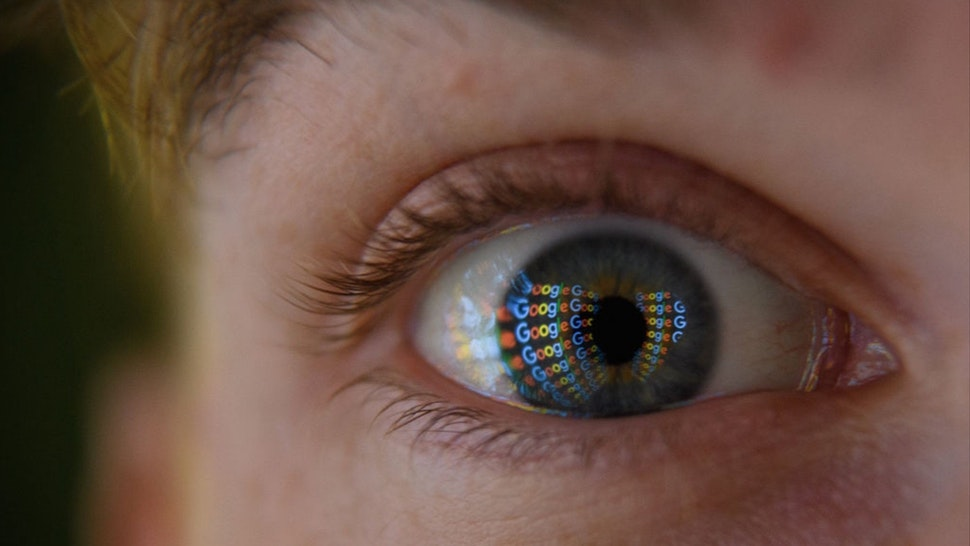 In this photo illustration, an image of the Google logo is reflected on the eye of a young man on August 09, 2017 in London, England.