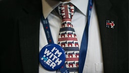"""A delegate wears a Democratic party donkey themed tie and button reading """"I'm With Her"""" during the Democratic National Convention (DNC) in Philadelphia, Pennsylvania, U.S., on Thursday, July 28, 2016."""