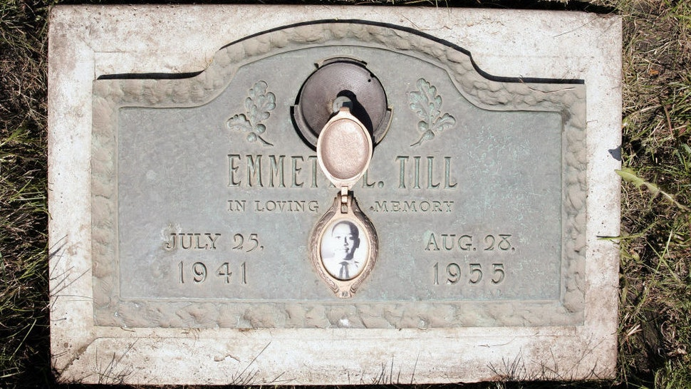 A plaque marks the gravesite of Emmett Till at Burr Oak Cemetery May 4, 2005 in Aslip, Illinois. The FBI is considering exhuming the body of Till, whose unsolved 1955 murder in Money, Mississippi, after whistling at a white woman helped spark the U.S. civil rights movement. (Photo by Scott Olson/Getty Images)