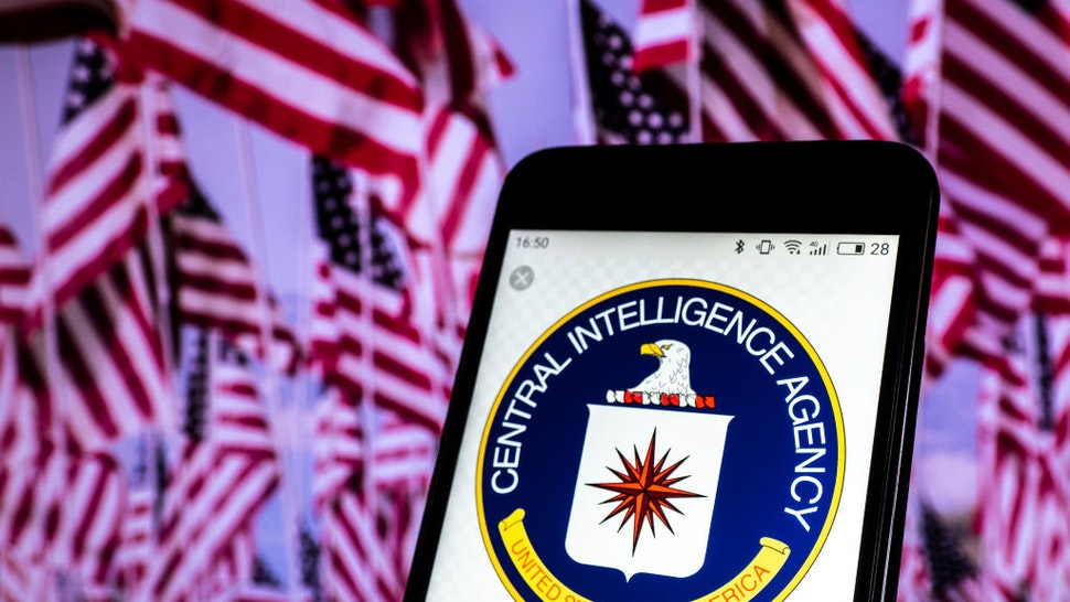 In this photo illustration, the Seal of United States Central Intelligence Agency seen displayed on a smartphone