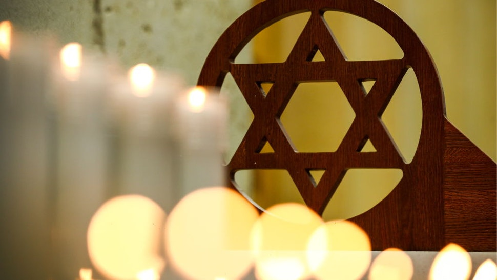 Lit candles at a prayer service at the Moscow Jewish Community Centre for the victims of the 27 October 2018 shooting attack on a synagogue in Pittsburgh, United States.