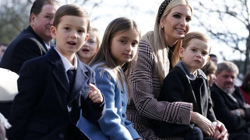 White House adviser and first daughter Ivanka Trump (3rd L), her children Arabella Kushner (2nd L), Joseph Kushner (L), and Theodore Kushner (R) attend a turkey pardoning event at the Rose Garden of the White House November 20, 2018 in Washington, DC.