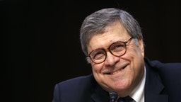 "William Barr, attorney general nominee for U.S. President Donald Trump, smiles during a Senate Judiciary Committee confirmation hearing in Washington, D.C., U.S., on Tuesday, Jan. 15, 2019. Barr says he'd let Special Counsel Robert Mueller ""complete his work"" and that he'd provide Congress and the public as much of the findings in the Russia probe as possible"