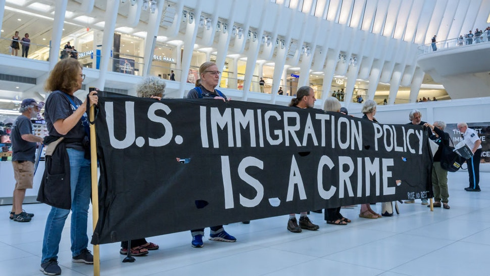 Members of the activist group Rise And Resist gathered at a silent protest inside The Oculus on September 12, 2019 holding NO RAIDS/CLOSE THE CAMPS/ABOLISH ICE banners, photographs of the children who have died in ICE custody, and photographs of the detention camps to object to Border Patrol and ICE treatment of immigrants, refugees, and asylum seekers.