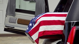 American flag over casket at military funeral