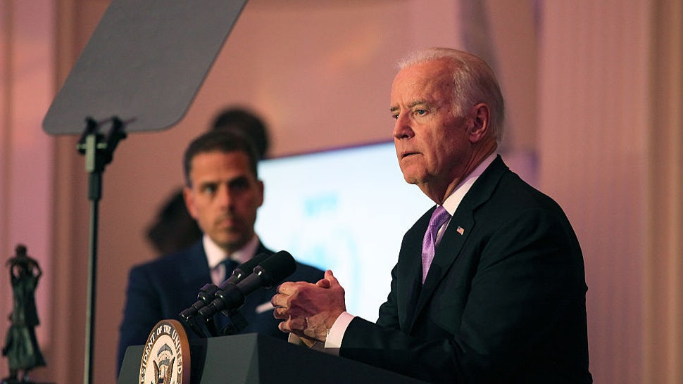 Hunter Biden (L) and U.S. Vice President Joe Biden speak on stage at the World Food Program USA's Annual McGovern-Dole Leadership Award Ceremony at Organization of American States on April 12, 2016 in Washington, DC.