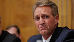 WASHINGTON D.C. - SEPTEMBER 27: U.S. Senator Jeff Flake (R-AZ) looks on during Judge Brett Kavanaugh's testimony to the Senate Judiciary Committee during his Supreme Court confirmation hearing in the Dirksen Senate Office Building on Capitol Hill September 27, 2018 in Washington, DC. Kavanaugh was called back to testify about claims by Christine Blasey Ford, who has accused him of sexually assaulting her during a party in 1982 when they were high school students in suburban Maryland