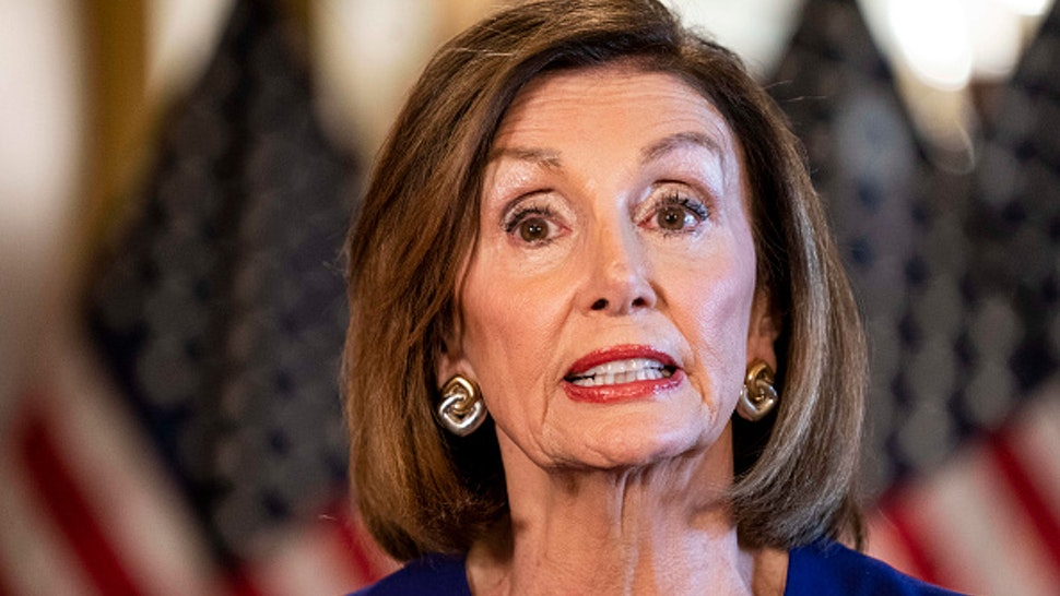 WASHINGTON, DC - September 24: From the Speaker's Balcony hallway, Speaker of the House Nancy Pelosi delivers a speech concerning a formal impeachment inquiry into President Donald Trump on Capitol Hill in Washington, DC on Tuesday September 24, 2019.