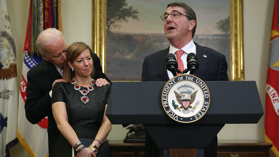 Ashton Carter (R) makes remarks after he was sworn in as U.S. Secretary of Defense as his wife Stephanie (2nd L) Vice President Joe Biden (L) listen February 17, 2015 in the Roosevelt Room of the White House in Washington, DC. Carter has become the 25th U.S. Secretary of Defense.