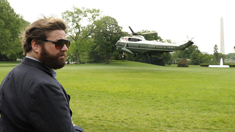 "Comedy actor Zach Galifianakis, who recently starred in the movie ""The Hangover"" witnesses the liftoff of Marine One helicopter, at the White House, bearing U.S. President Barack Obama, in Washington, D.C., May 2, 201,0 on his way to Louisiana, where he will conduct a personal assessment of the aftermath of the explosion of a BP oil rig in the Gulf. (Photo by Mike Theiler/Black Star)"