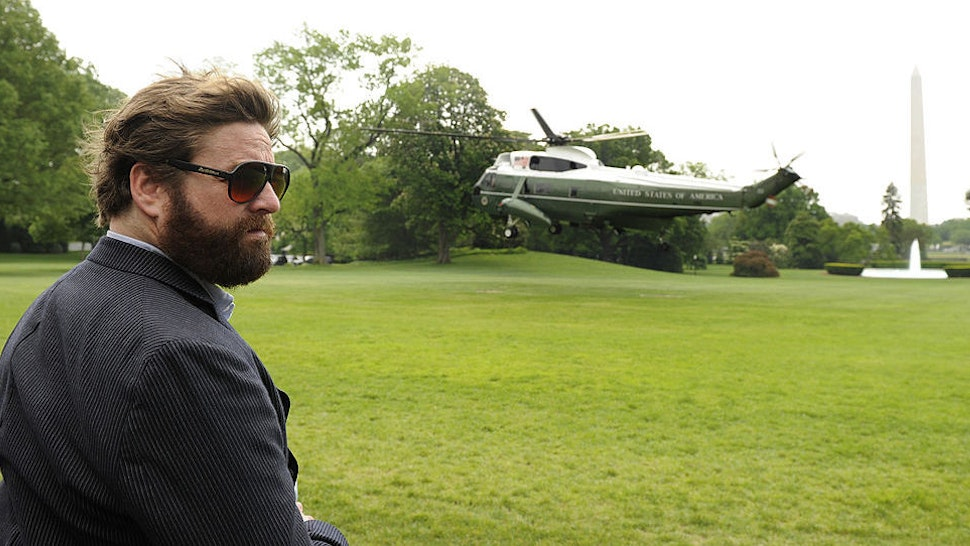 """Comedy actor Zach Galifianakis, who recently starred in the movie """"The Hangover"""" witnesses the liftoff of Marine One helicopter, at the White House, bearing U.S. President Barack Obama, in Washington, D.C., May 2, 201,0 on his way to Louisiana, where he will conduct a personal assessment of the aftermath of the explosion of a BP oil rig in the Gulf. (Photo by Mike Theiler/Black Star)"""