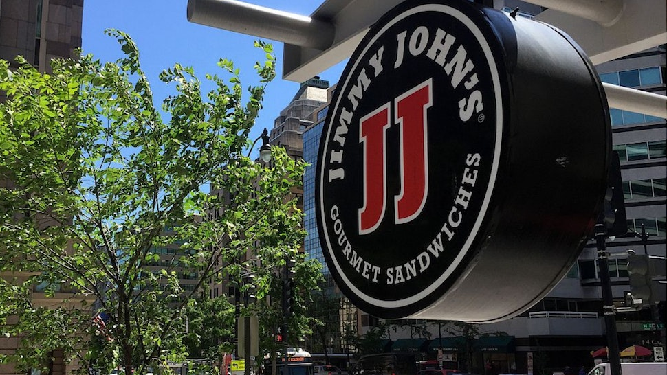 A logo of the sandwich restaurant chain, specializing in delivery Jimmy John's hangs outside one of their shops in downtown Washington, DC, June 9, 2016