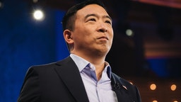 Andrew Yang, founder of Venture for America stands on stage during the Democratic presidential candidate debate