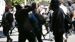 Unidentified Rose City Antifa members beat up Andy Ngo, a Portland-based journalist, on June 29, 2019 in Portland, Oregon.