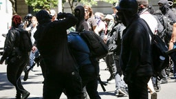 Unidentified Rose City Antifa members beat up Andy Ngo, a Portland-based journalist, on June 29, 2019 in Portland, Oregon.