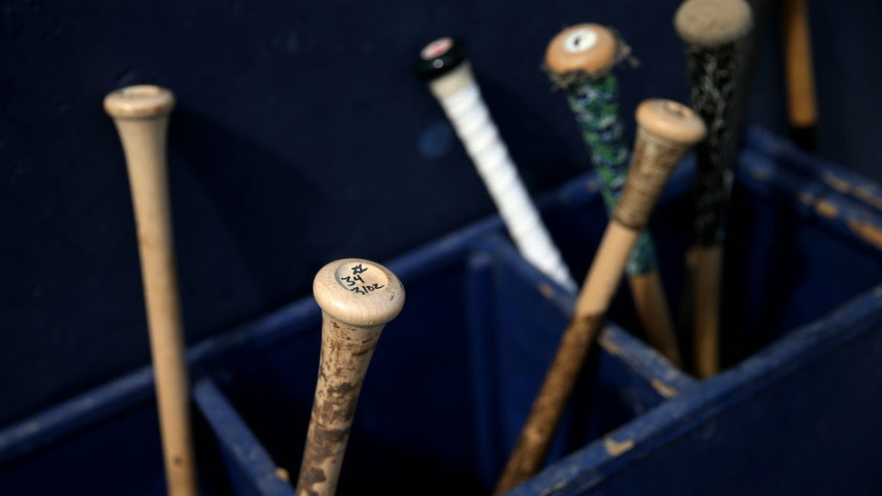 BREWSTER, MA - AUGUST 11: Bats next to the Brewster Whitecaps dugout during game one of the Cape Cod League Championship Series against the Bourne Braves at Stony Brook Field on August 11, 2017 in Brewster, Massachusetts. Cape Cod League games are a popular destination for MLB scouts. The collection of some of the country's top college players combined with the league's use of wooden bats help indicate a prospects success in the big leagues.