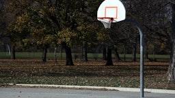 A concrete basketball court