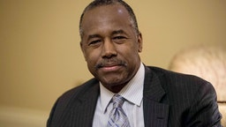 US Housing and Urban Development (HUD) Secretary nominee Ben Carson poses for photos before a meeting with Senate Majority Leader Mitch McConnell at the Capitol in Washington, DC, on December 7, 2016.