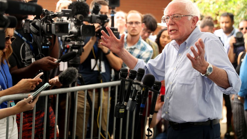 Democratic presidential candidate Sen. Bernie Sanders (I-VT) talks to journalists after speaking at the Des Moines Register Political Soapbox during the Iowa State Fair August 11, 2019 in Des Moines, Iowa.