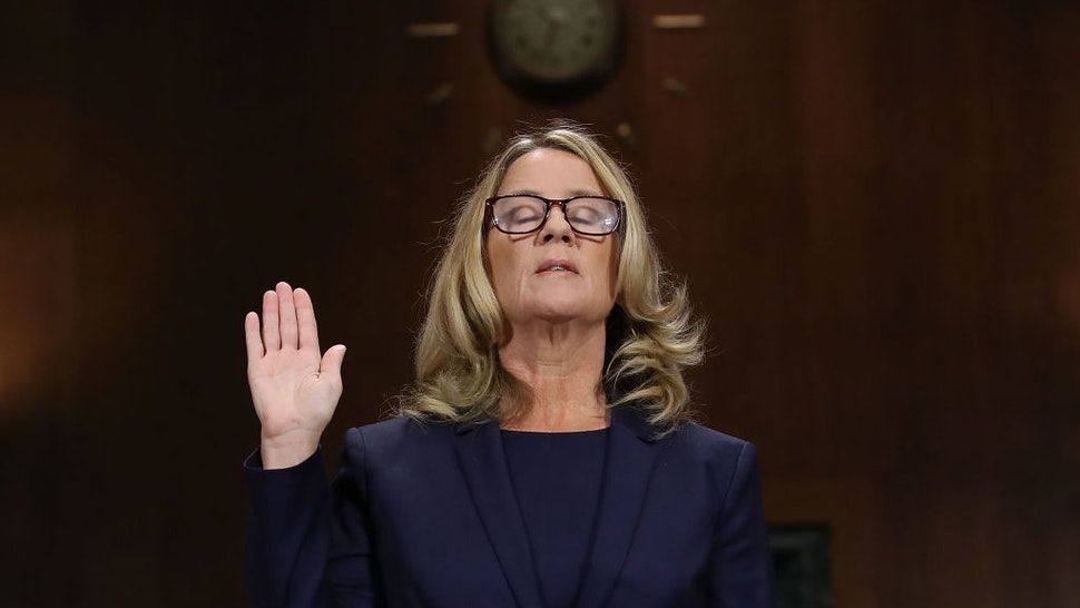 WASHINGTON, DC - SEPTEMBER 27: Christine Blasey Ford is sworn in before testifying the Senate Judiciary Committee in the Dirksen Senate Office Building on Capitol Hill September 27, 2018 in Washington, DC.