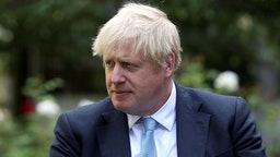 Britain's Prime Minister Boris Johnson looks on as he speaks with British actress Barbara Windsor (not pictured) after she delivers a petition calling for urgent action on dementia care in the garden at 10 Downing Street on September 2, 2019.