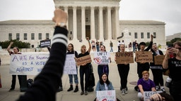 WASHINGTON, DC - OCTOBER 6: Protesters rally against the confirmation of Supreme Court nominee Judge Brett Kavanaugh, outside of the Supreme Court, October 6, 2018 in Washington, DC. The Senate is set to hold a final vote Saturday evening to confirm the nomination of Judge Brett Kavanaugh to the U.S. Supreme Court.