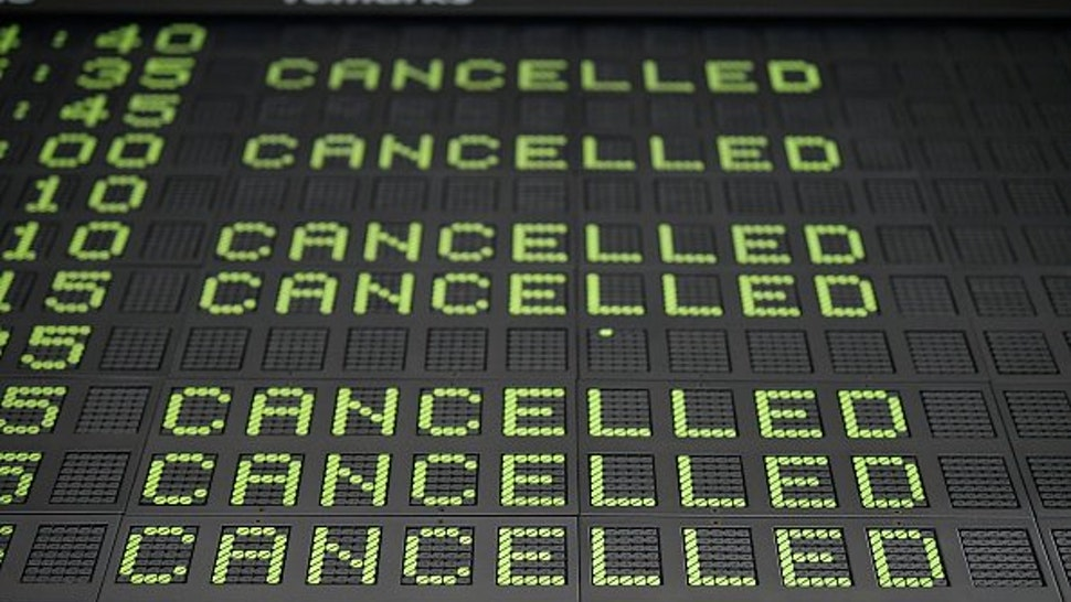 An information board at the Ljubljana Joze Pucnik Airport displays cancelled flights of Slovenian flag carrier Adria Airways in Brnik, Slovenia, on September 24, 2019.