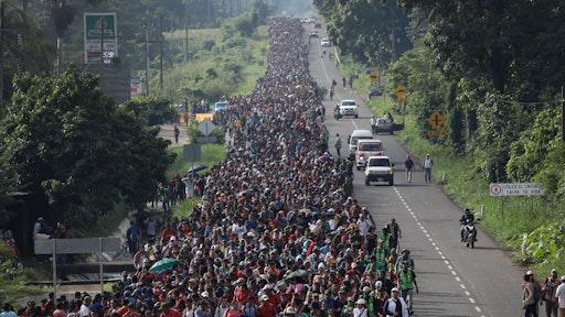 A migrant caravan walks into the interior of Mexico after crossing the Guatemalan border on October 21, 2018 near Ciudad Hidalgo, Mexico