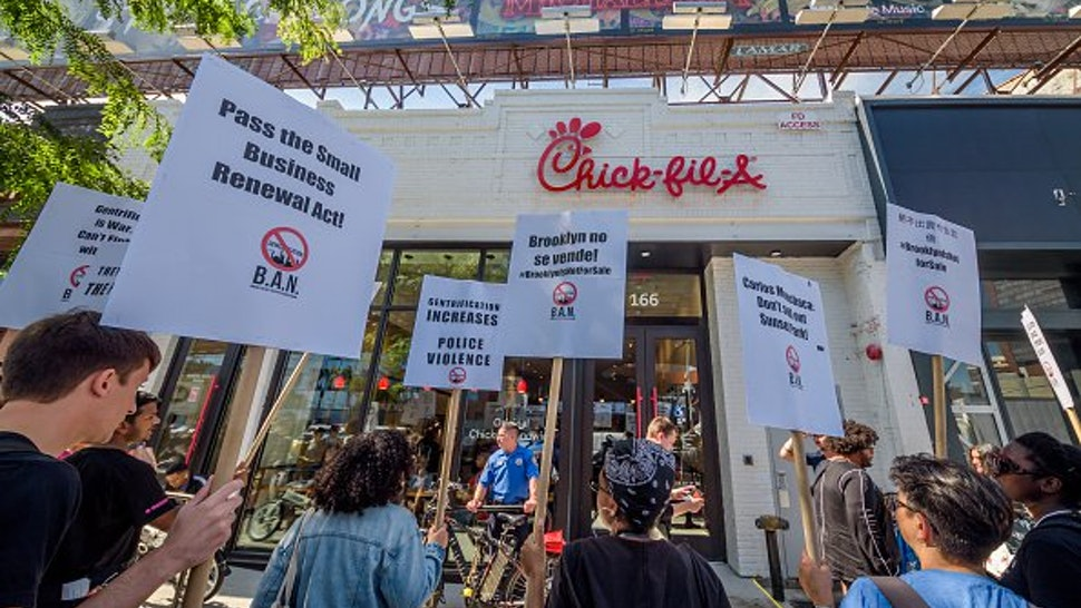 Protesters targeted Chick-Fil-A for their alleged homophobe stance - some of the banners accused Chick-Fil-A of being anti gay.