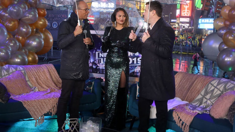 NBC'S NEW YEAR'S EVE -- Pictured: (l-r) Lester Holt, Chrissy Teigen, and Carson Daly during NBC's New Year's Eve --