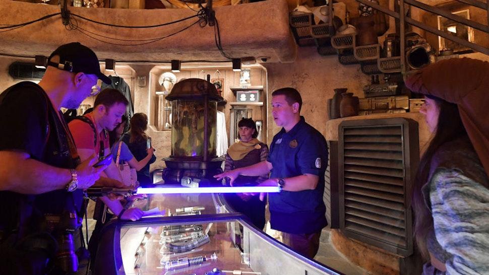 Visitors Build Customized Lightsabers At Disneyland.