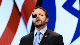 U.S. Representative Dan Crenshaw (R-TX) seen speaking during the American Israel Public Affairs Committee (AIPAC) Policy Conference in Washington, DC.