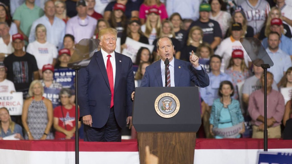 State Senator Dan Bishop, a Republican from North Carolina, speaks during a rally with U.S. President Donald Trump, left, in Greenville, North Carolina, U.S., on Wednesday, July 17, 2019.