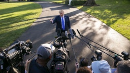 U.S. President Donald Trump speaks to members of the media before boarding Marine One on the South Lawn of the White House in Washington, D.C., U.S., on Friday, Aug. 30, 2019.