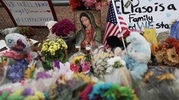 Flowers and mementos are seen at a makeshift memorial outside Walmart, near the scene of a mass shooting which left at least 20 people dead, on August 4, 2019 in El Paso, Texas.