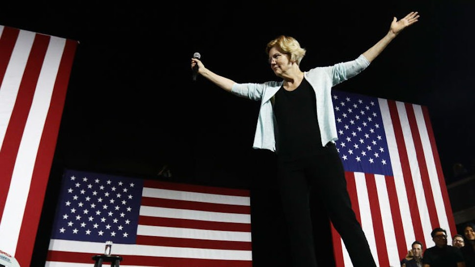 Democratic Presidential candidate Senator for Massachusetts Elizabeth Warren prepares to speak during a town hall meeting at Shrine Auditorium on August 21, 2019 in Los Angeles, California.