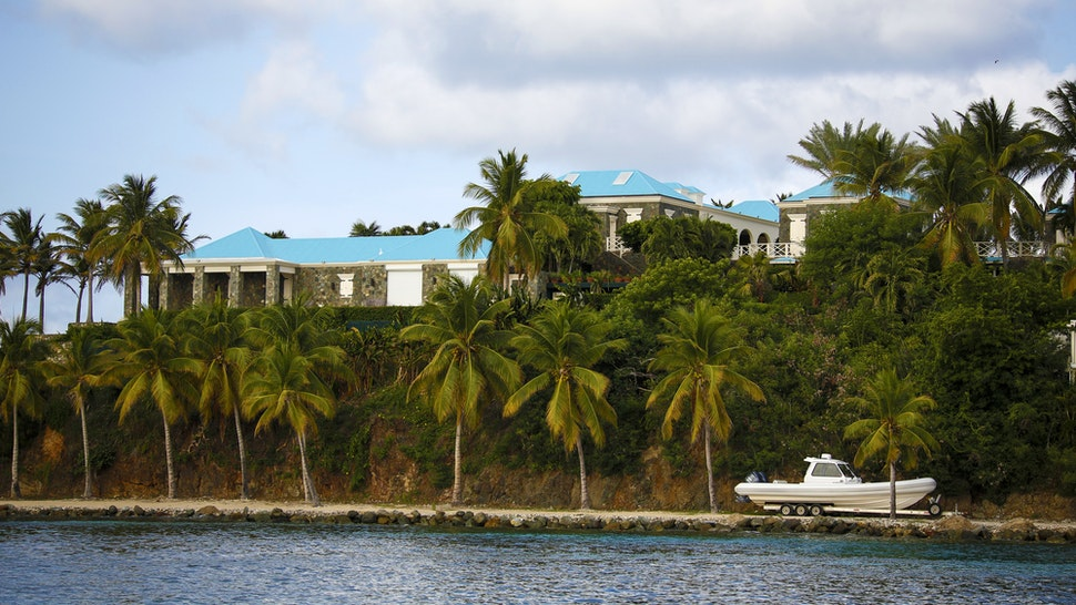 A house stands above a boat on Little St. James Island, owned by fund manager Jefferey Epstein, in St. Thomas, U.S. Virgin Islands, on Wednesday, July 10, 2019. This is whereEpstein- convicted of sex crimes a decade ago in Florida and nowchargedin New York with trafficking girls as young as 14 - repaired, his escape from the toil of cultivating the rich and powerful.