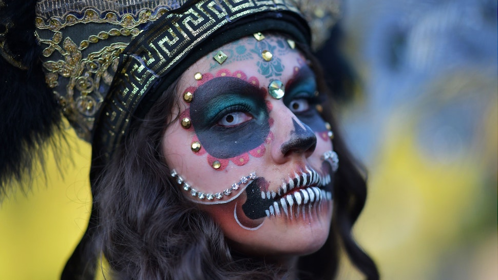 A woman in costume poses as she attends Hollywood Forever Cemetery's 19th annual Dia De Los Muertos event on October 27, 2018.
