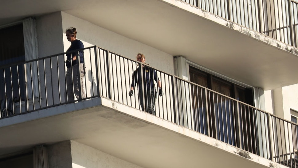 AVENTURA, FL - OCTOBER 26: FBI Agents walk on along the balcony of a condo in the building that has a possible connection to alleged bomber Cesar Sayoc and his mother on October 26, 2018 in Aventura, Florida. Mr. Sayoc was arrested today on allegations that he was the person that mailed pipe bomb devices that targeted critics of President Donald Trump and have been recovered in New York, Washington D.C., California and South Florida, all with the return address of Debbie Wassermann-Schultz's office.