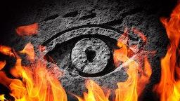 A stone eye engulfed in flames