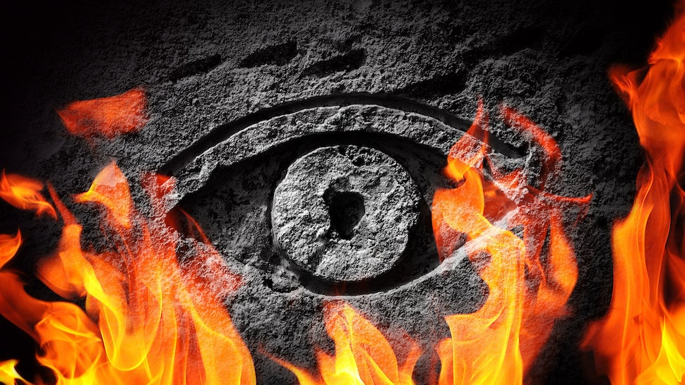 A stone eye engulfed in flames